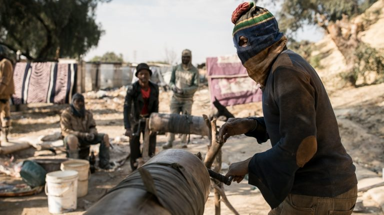 Illicit gold trade fuels conflict in South African mining town